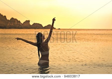 Girl relaxing in the water at the seaside