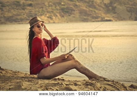 Smiling woman at the beach