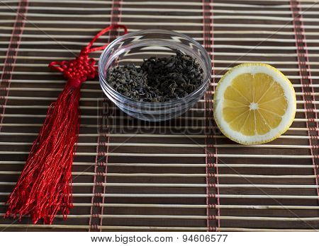 saucer with tea granules for preparation of drink