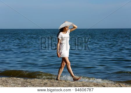 Pretty woman walking on beach