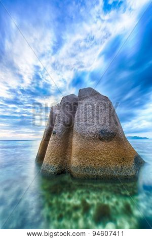 Beautifully shaped granite boulder in the sea of Seychelles at Anse Source d'Argent beach taken with a long exposure.