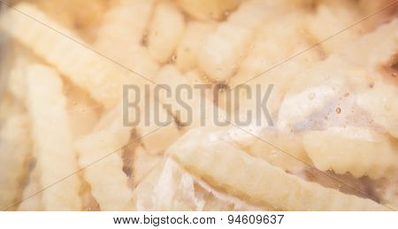 French fries package on wood background