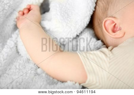 Baby hand on blanket, closeup