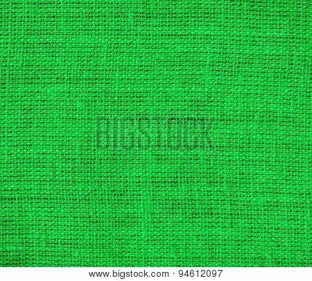 Dark pastel green burlap texture background