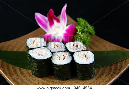 Maki tuna sushi  in a black background