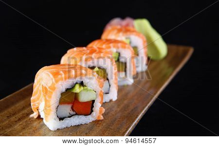 Maki salmon sushi in a black background