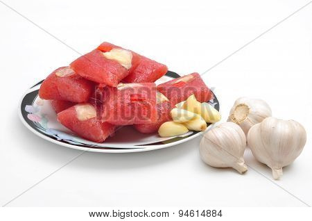 Vietnamese Fermented Pork Roll or Nem Lai Vung on a white background