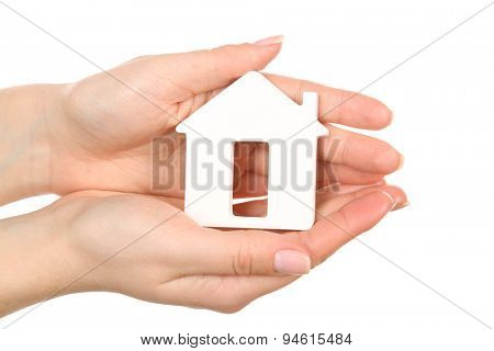 Female hands holding model of house isolated on white