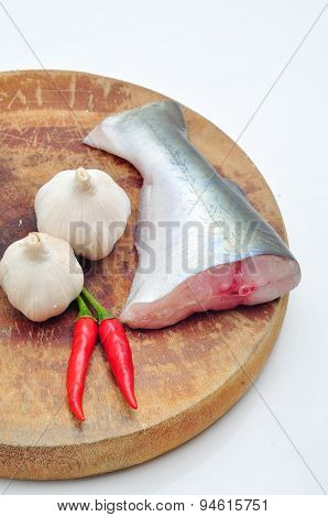 Pangasius or Vietnamese catfish in the kitchen in a white background