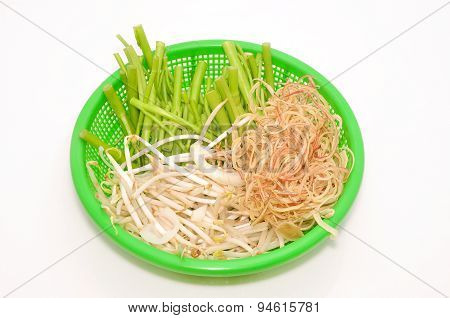 Basket of Vietnamese herbs on a white background