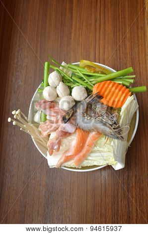 Hot pot of Thai style with shrimp and salmon