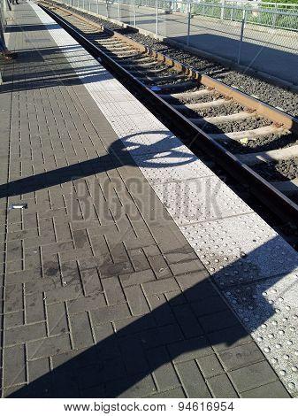 Shadows On Train Tracks