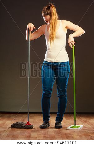 Young Cleaning Woman Mopping Floor