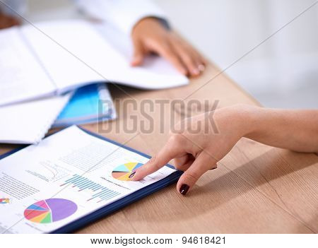 Portrait of a businesswoman sitting at a desk with a laptop.