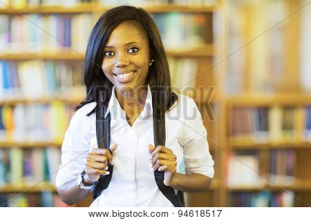 smiling african college girl looking at the camera