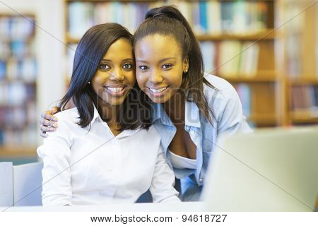 portrait of young african college students friends in library