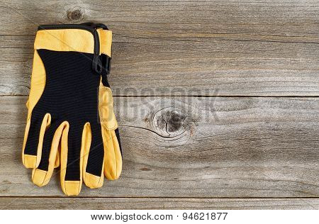 New Leather And Nylon Work Gloves On Rustic Wooden Boards