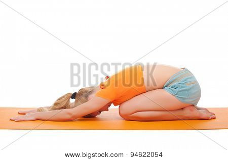 Young woman doing gymnastic exercises isolated