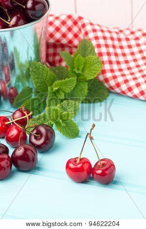 Cherries In Blue Wooden Table