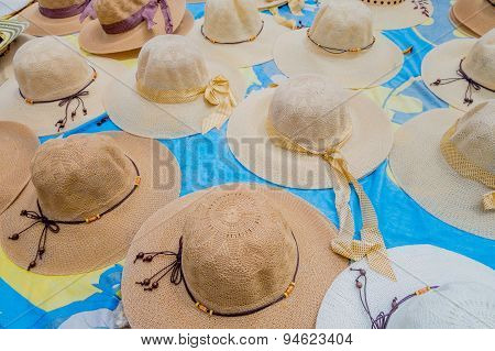 Traditional Colombian colorful straw summer beach woman hats from street vendors in Colombia's most
