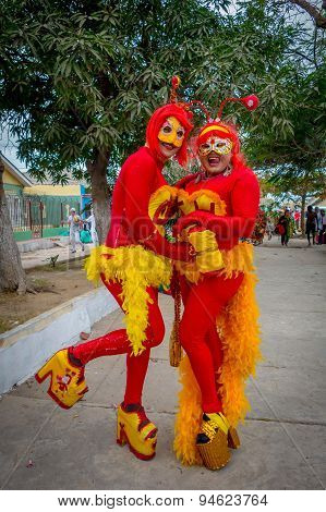 Two joyful girls dressed as chapulin colorado and high heels  participate in Colombia's most importa