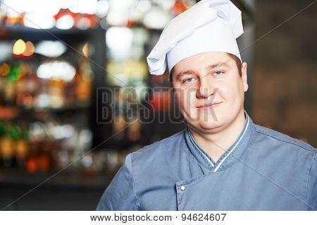 portrait of male cook chef at restaurant kitchen