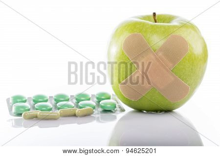 Fresh apple and pills blister pack