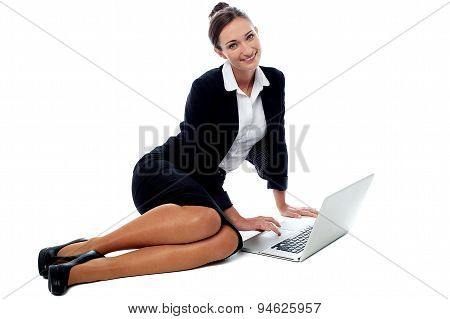 Female Executive Working In Laptop.
