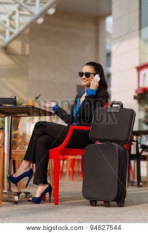 Business Woman In Cafe At Station
