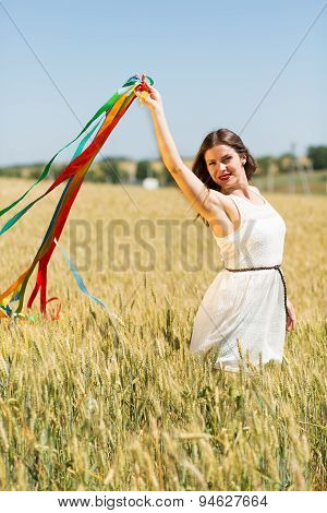 Happy Girl Holding Colorful Ribbons