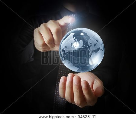 Man holding  earth in hand