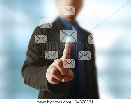 Businessman pressing virtual icons, technology concept