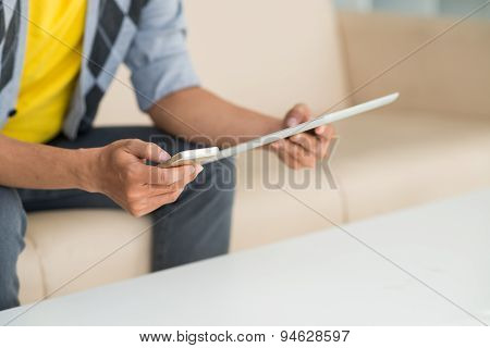 Man With Digital Tablet And Smartphone