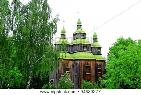 Beautiful old wooden church in forest with blue sky background