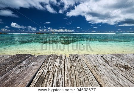 Beautiful beach and old wooden pier at Seychelles