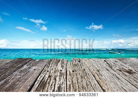 Beautiful beach and old wooden pier at Seychelles, Mahe
