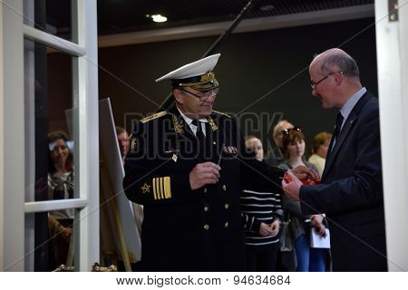 ST. PETERSBURG, RUSSIA - JUNE 24, 2015: Admiral Y. Sysuyev and vice president of Russian Geographical Society K. Chistyakov open the exhibition