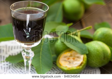 Glass of walnut liqueur