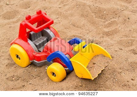 Child's Bright Plastic Digger Toy