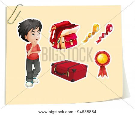 Stickers of a boy and other accessories on a paper