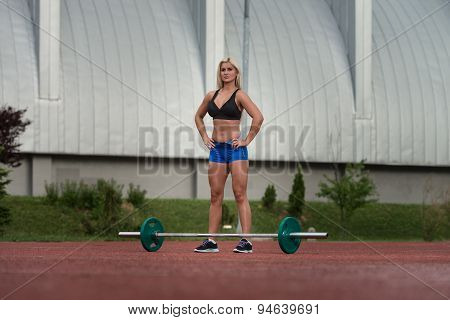Portrait Of A Young Woman With Weights Outdoor