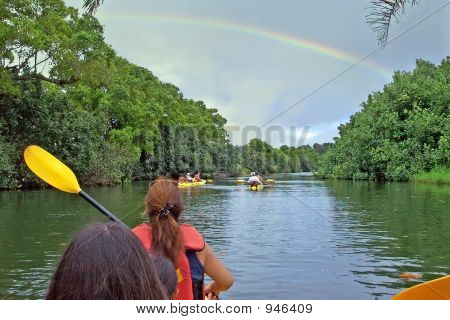 Kayaking In Kauai Under A Bright Rainbow