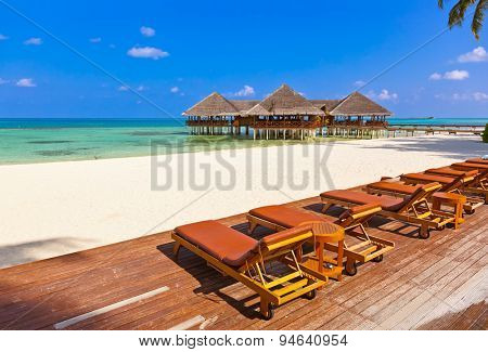 Cafe on tropical Maldives island - nature travel background