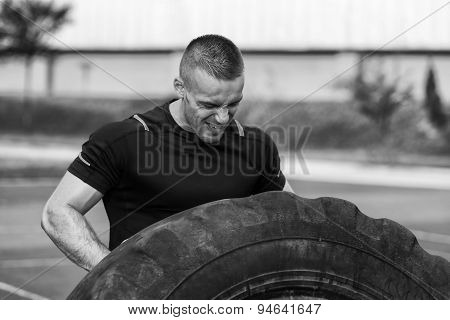 Young Man Turning Tires Outdoor