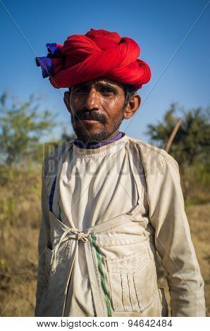 GODWAR REGION, INDIA - 13 FEBRUARY 2015: Rabari tribesman holds traditional axe on field. Rabari or Rewari are an Indian community in the state of Gujarat.