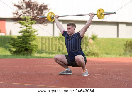 Young Man Doing A Overhead Squat Exercise Outdoor