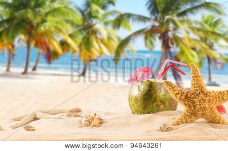 summer coconut cocktail on tropical beach.