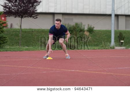 Athlete Running To The Cone