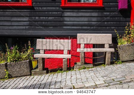 Two stone benches on the street in Bergen