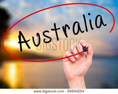 Man Hand writing Australia with black marker on visual screen